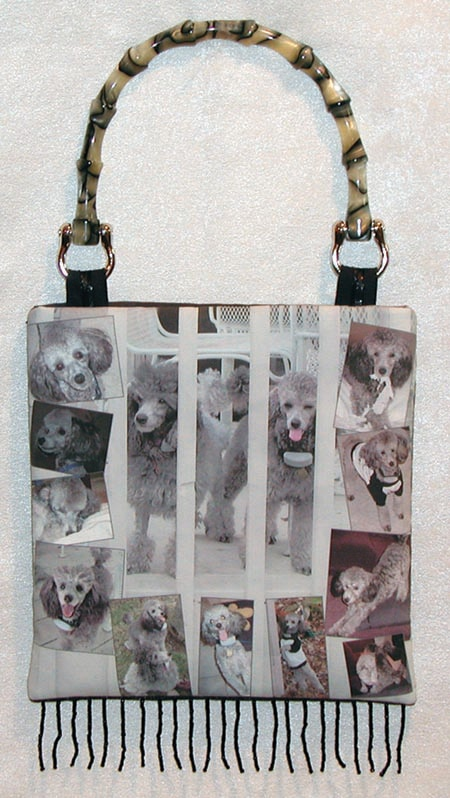 Handbag with many pictures of dogs.