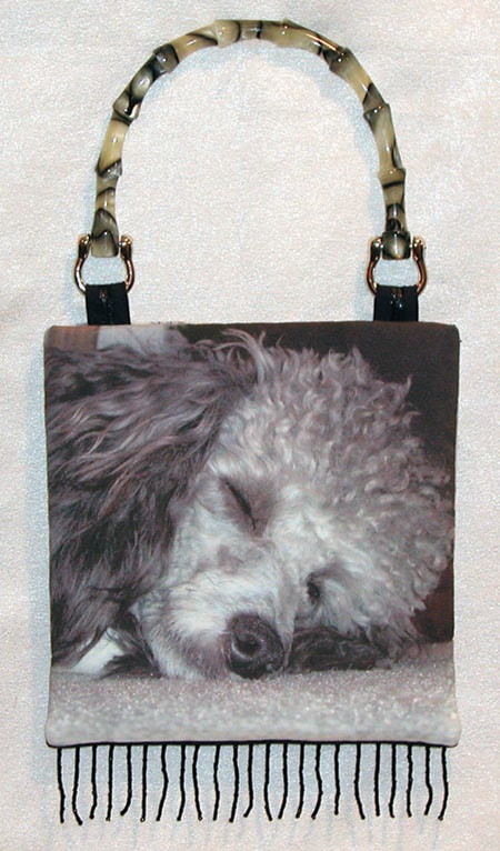 handbag with picture of dog printed on it.