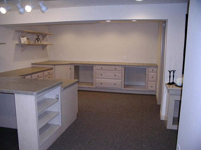 Sewing studio with built-in shelving, counters, and drawers.