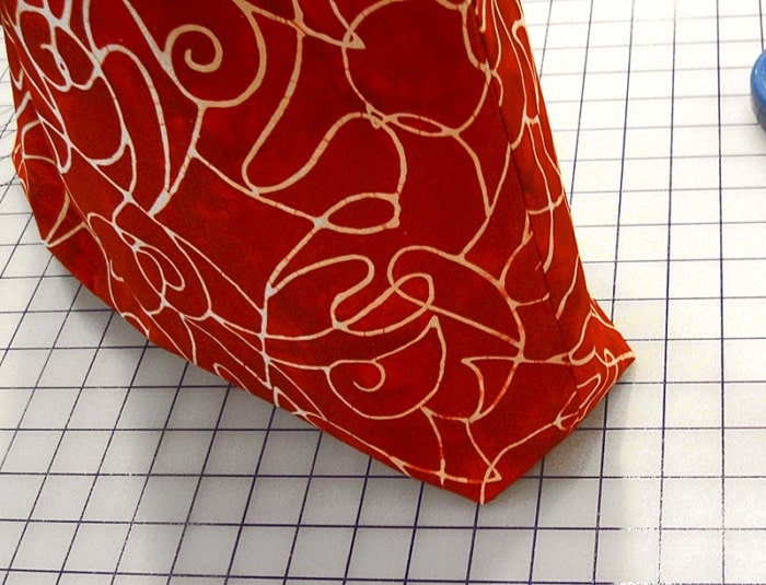 Close-up showing the finished boxed corner of a fabric bag.