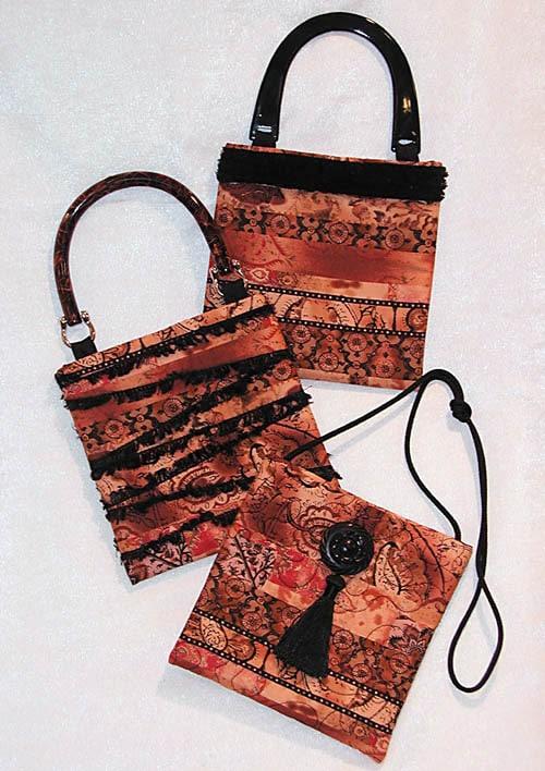 three small handbags