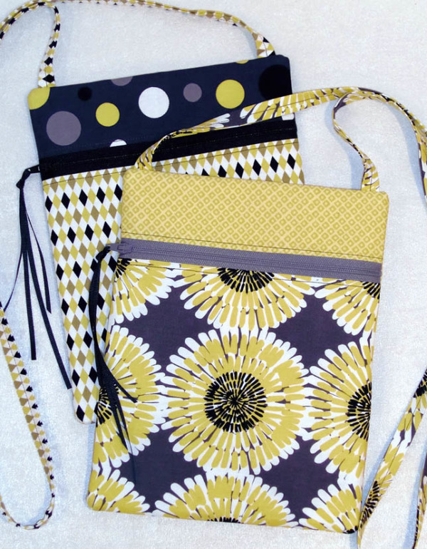 Two stacked small crossbody bags in yellow and gray fabrics.