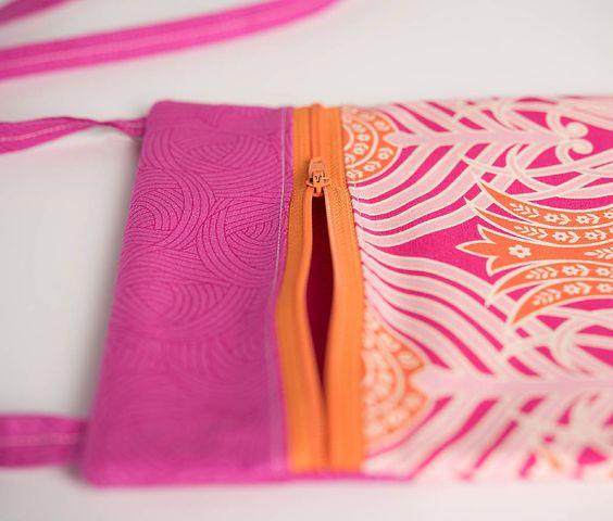 Close up of an open zipper on a small purse.