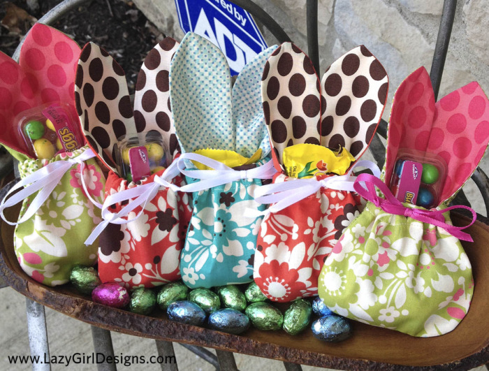 Fabric bags with bunny ears filled with Easter candy