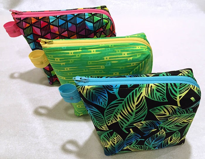 Three small zipper pouches.