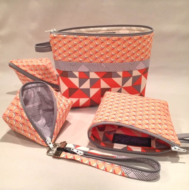 Small zipper pouches in fabrics by #AngelaWalters Sweetpea Pods, Becca Bags, and Fobio key fob by #LazyGirlDesigns