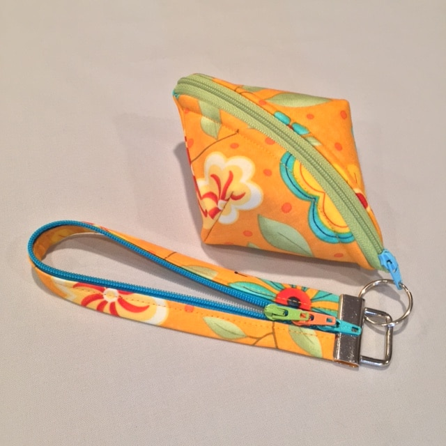 DIY wristlet of Sweetpea Pods zippered pouch and Fobio key fob in #ModaFabric #LazyGirlDesigns