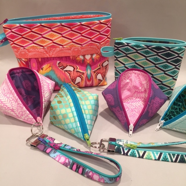 Small zipper pouches and more in gorgeous #TulaPink fabrics. Sweetpea Pods, Becca Bags, and Fobio key fobs by #LazyGirlDesigns