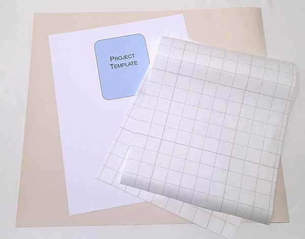 supplies to add iron on vinyl to a paper template
