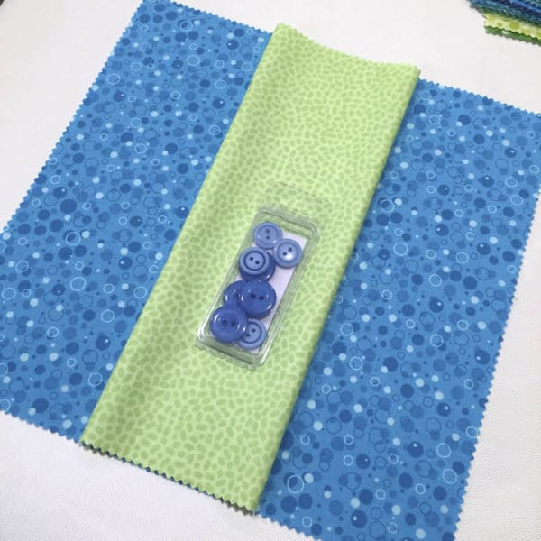 Auditioning buttons and fabric for a sewing project