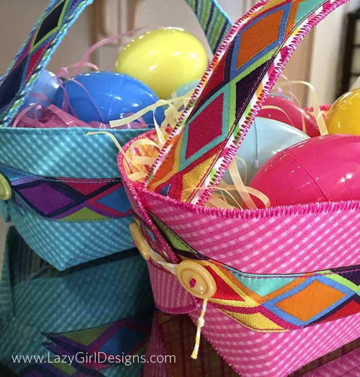 Close up picture of buttons and ties at the end of a Button Boats Easter Basket filled with grass and plastic eggs.