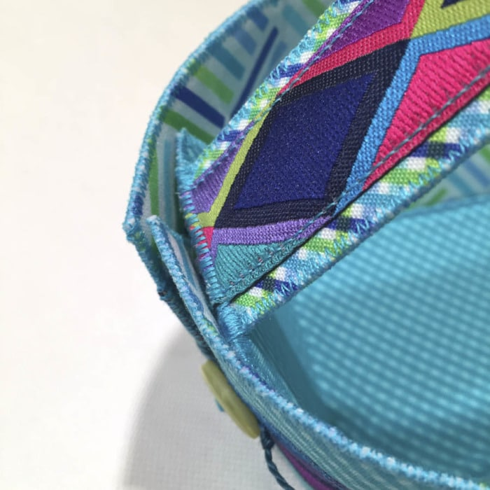 Close up picture of zigzag stitching showing where a handle is attached to a Button Boats organizer to make it into an Easter Basket.