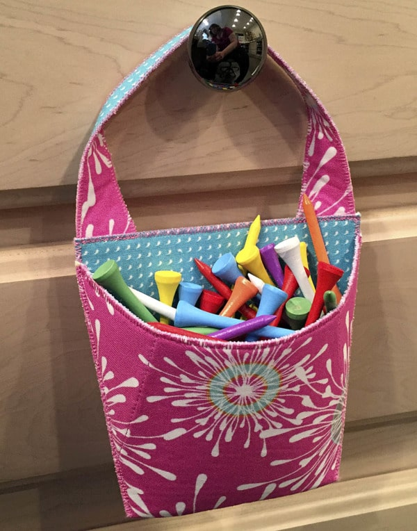 Use a Hang On to organize golf tees in the sewing room.