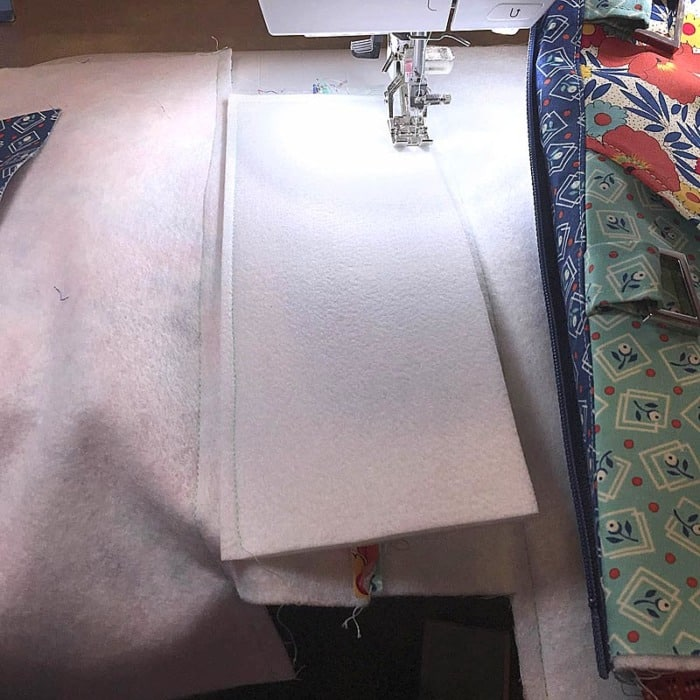 Sewing Tip: Add tape or glue between layers hold bag bottom support in place while sewing.