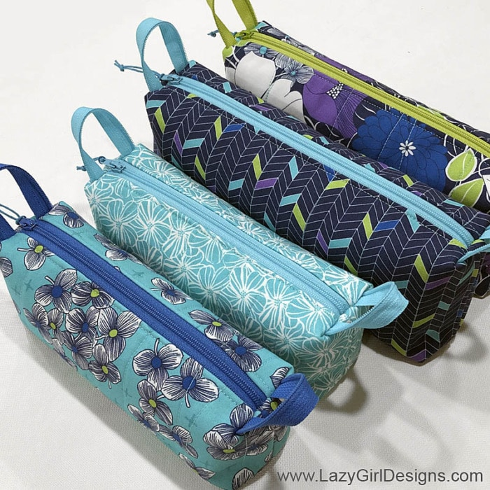 Group of small zipper pouches in coordinating fabrics and zippers