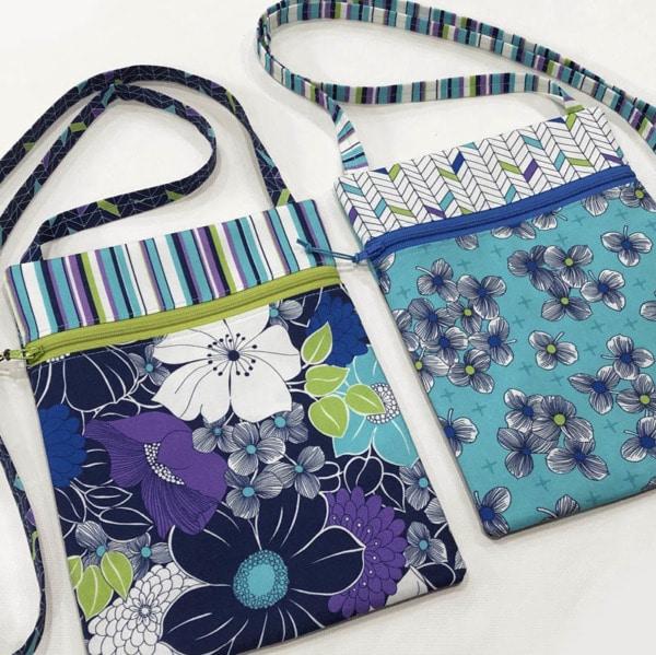 Two small coordinating zipper handbags.