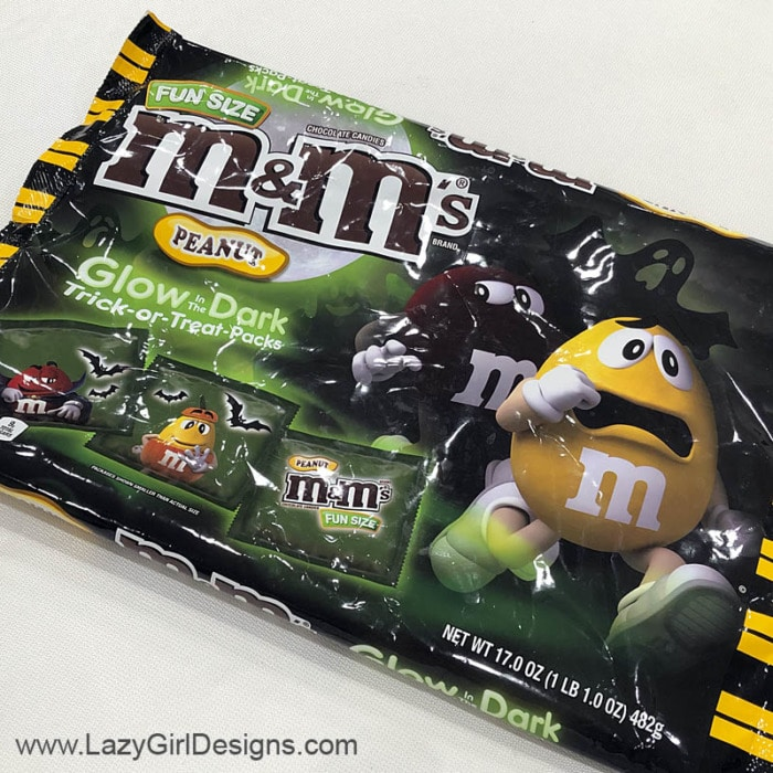 M&M candy in glow in the dark wrappers.