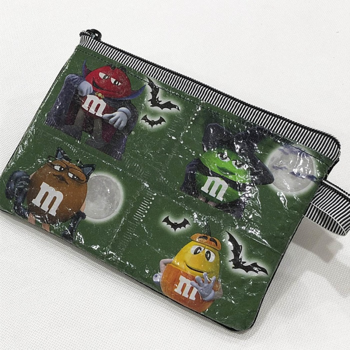 Zipper pouch made with laminated candy wrappers.