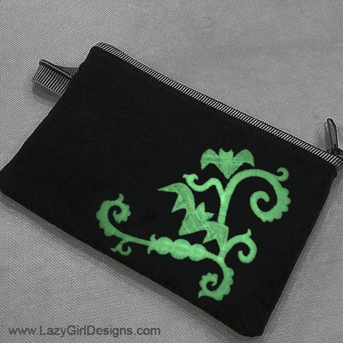 Glow in the dark embroidery thread on a small zipper pouch.