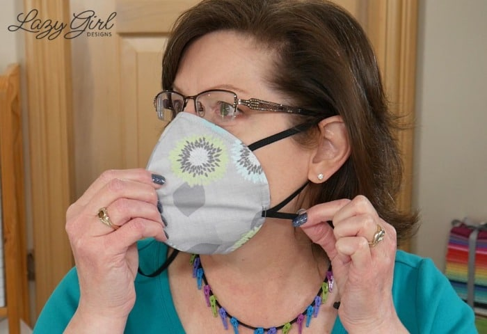 Face mask with adjustable ear loop.