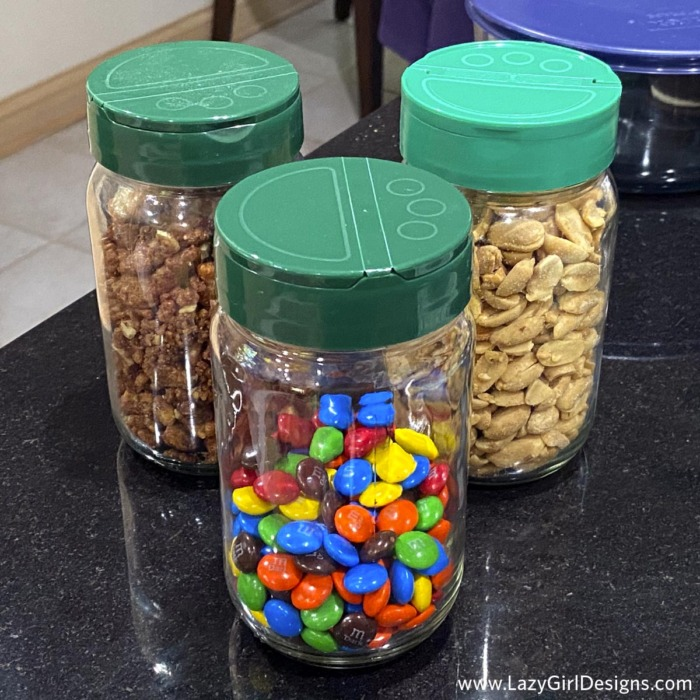 Glass jars filled with peanuts and chocolate