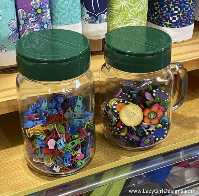 Glass jars filled with sewing supplies as a storage hack